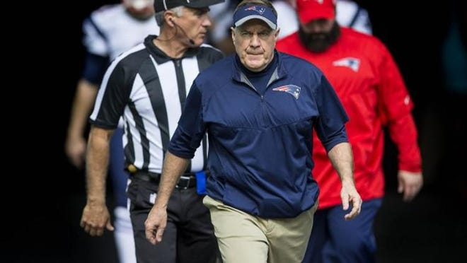 New England Patriots head coach Bill Belichick, enters the field before the start of the game against the Miami Dolphins Sunday January 01, 2017 at Hard Rock Stadium in Miami Gardens.