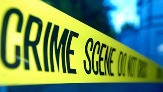 Police investigate a gray car with multiple bullet holes involved in a fatal shooting on Monday in Kansas City. The victim is a 1-year-old boy, the city's youngest homicide victim this year, police said. Tyron Payton was in the back seat of a car with three other adults when someone opened fire on their vehicle Monday afternoon, police said.