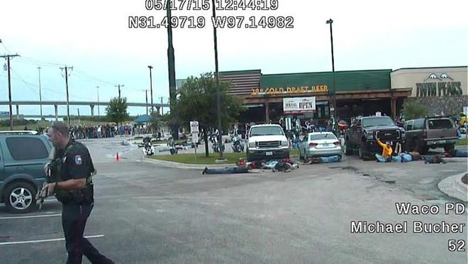This image from a May 17, 2015, police dash-cam video shows the parking lot of a Waco Twin Peaks restaurant after a shooting involving two rival biker gangs and police. WACO POLICE DEPARTMENT