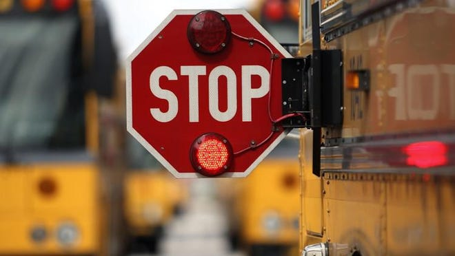 A New Hampshire woman says her fifth-grade son was kicked off a school bus for the rest of the year because of a mask-wearing infraction.