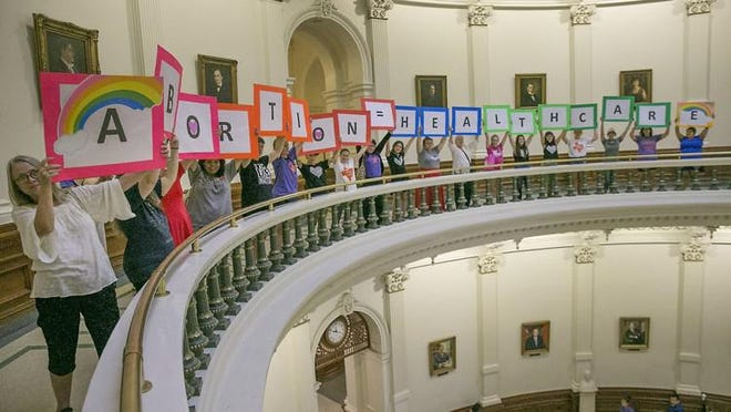 Abortion rights advocates protest abortion restrictions being debated in the Texas House in July 2017 at the Capitol.