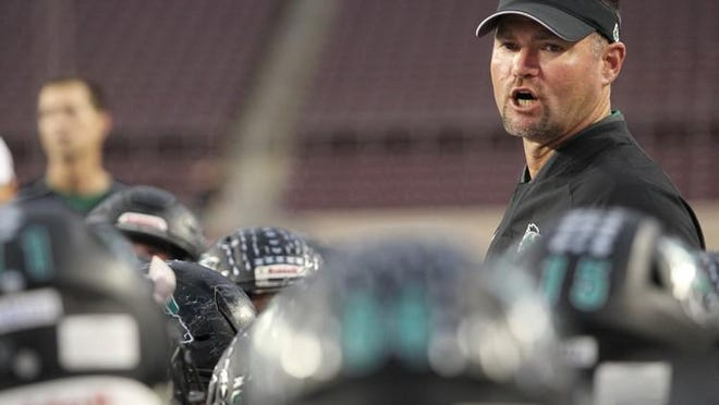 Cedar Park head coach Carl Abseck led the Timberwolves to a 60-7 win over Leander Friday.
