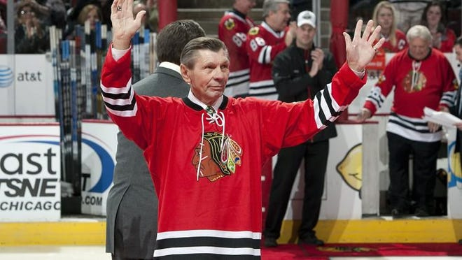 Former Chicago Blackhawks player, Stan Mikita, of the 1961 Stanley Cup Championship team is honored before the game against the New York Islanders on January 9, 2011 at the United Center in Chicago, Illinois.
