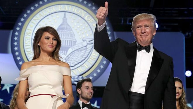 President Donald Trump and first lady Melania Trump thank guests during the inaugural Freedom Ball at the Washington Convention Center Friday in Washington, D.C.