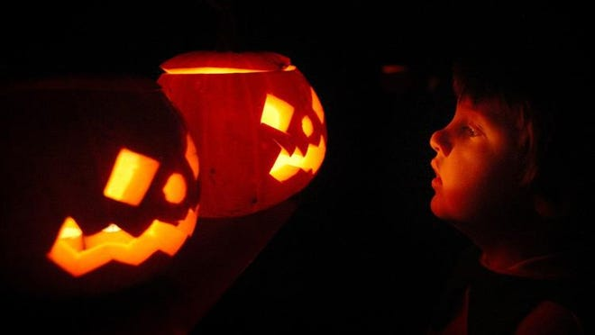 A child enjoys traditional candle-lit Halloween pumpkins on October 31, 2007 in London.