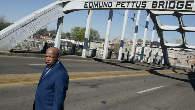 Congressman John Lewis stands on the Edmund Pettus Bridge on Sunday, March 4, 2018, in Selma, Ala., during the annual commemoration of ?Bloody Sunday,? the day in 1965 when voting rights protesters were attacked by police as they attempted to cross the Edmund Pettus Bridge.