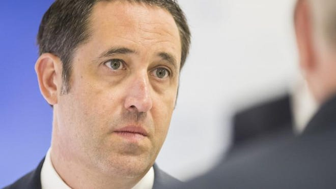 Texas Comptroller Glenn Hegar gave a somewhat less bleak financial forecast buoyed by federal spending programs and higher-than-expected tax collections in some sectors such as online sales.