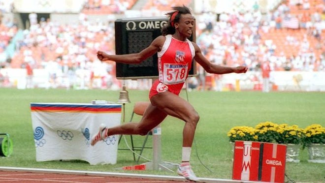 Jackie Joyner-Kersee of East St. Louis, Ill., strides toward finish line in the 200 meter portion of the heptathlon in Seoul, Sept. 23, 1988. She won the race in 22.56 seconds and went on to lead the field after four of the seven hepthathlon events.