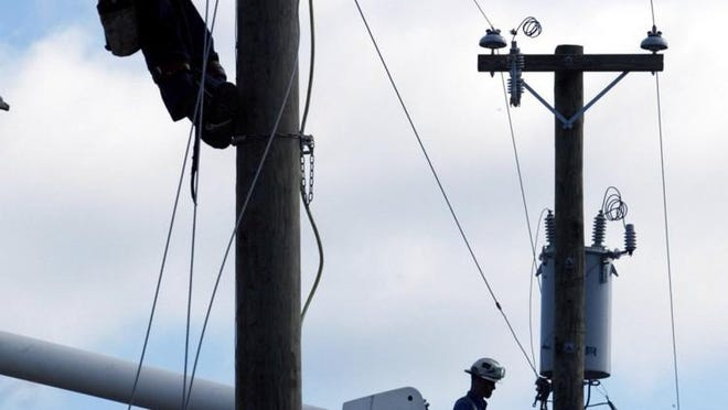 Winds reaching gusts up to 60 mph whipped across the lakeshore Sunday, downing power lines and disrupting service for hundreds of Consumers Energy customers.