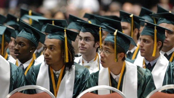 The 2004 graduation at Suncoast High School, Palm Beach County's first IB school, starting in 1989. Palm Beach Post file photo