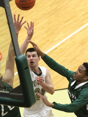 Jake Wendel goes up for two of his 18 points  against Novi Thursday at Howell High School.