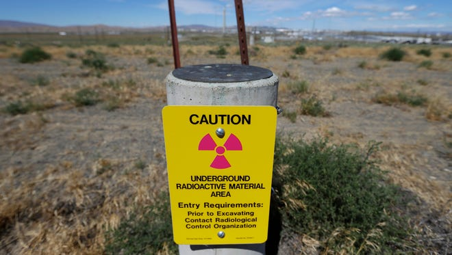 A sign warns of radioactive material stored underground on the Hanford Nuclear Reservation.
