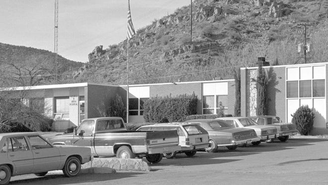 "In 1988 the George R. Aiken Hospital in Kanab was photographed by Spectrum photographer Nancy Rhodes. According to his obituary in theDeseret News, Dr. Aiken built Kane County's first hospital in Kanab during the Great Depression, ""largely by allowing his patients to pay fees by working on the project or by supplying food or merchandise."" The hospital building shown in the then image replaced the original hospital built by Aiken opened in 1962 and served as Kane County's primary medical facility until 1997. After the building ceased functioning as a hospital it was used to house a private Christian school and as a home for Kanab's headstart program but for the past several years had sat empty. This spring, however, JoAnn and Jeff Michelsen renovated the building and began operating the Cowboy Bunkhouse, as can be seen in the now image taken by Spectrum photographer Jud Burkett. The Cowboy Bunkhouse is a hostel style boarding house for seasonal workers spending the summer in the Kanab area. ."