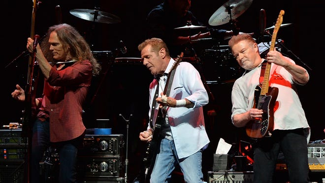 "NASHVILLE, TN - OCTOBER 16:  Timothy B. Schmit, Glen Frey and Don Henley of the Eagles perform during ""History Of The Eagles Live In Concert"" at the Bridgestone Arena on October 16, 2013 in Nashville, Tennessee.  (Photo by Rick Diamond/Getty Images)"