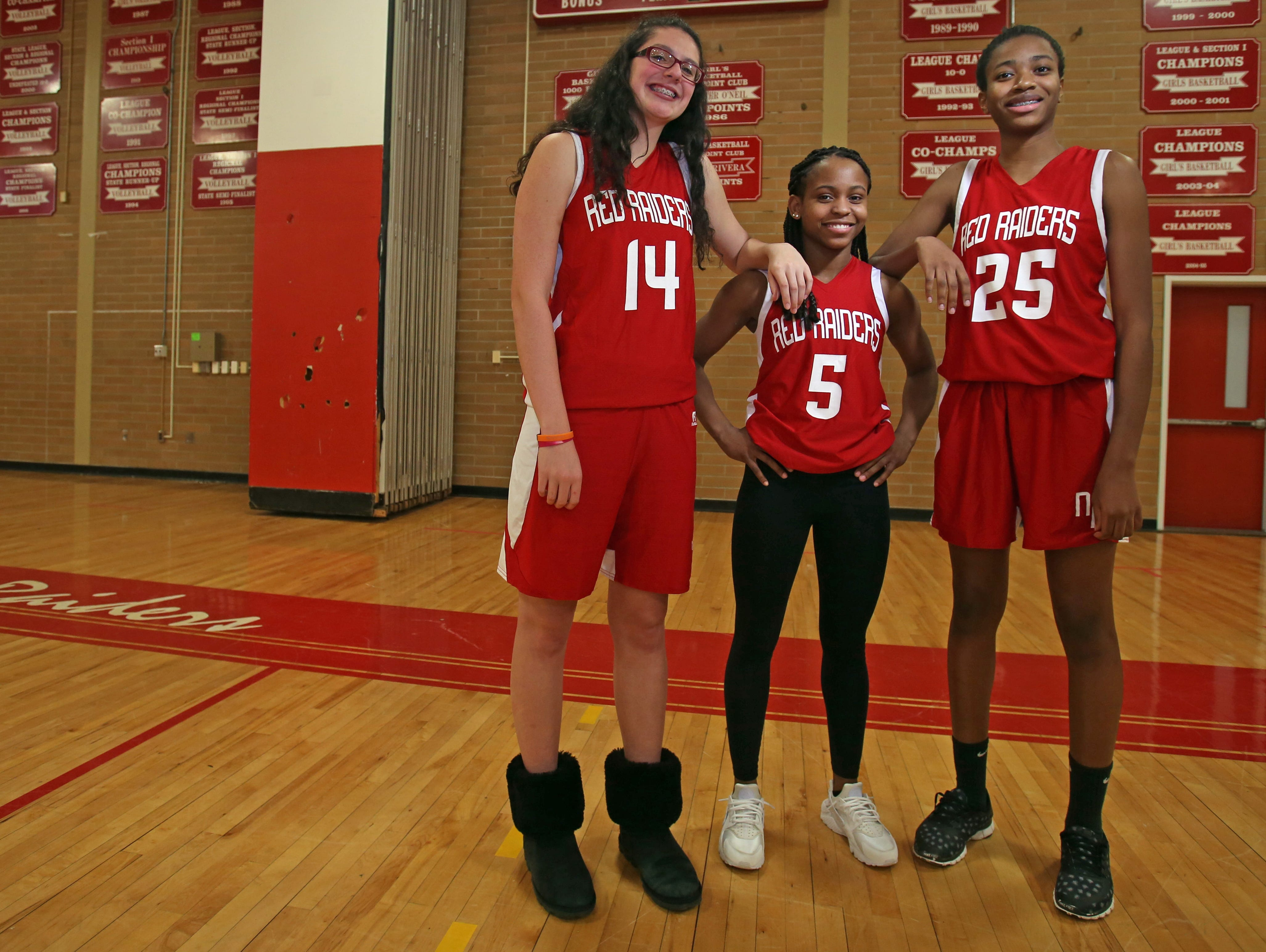 From left, North Rockland's Trinity Boescker, Gabby Cajou, and Pamela Miceus pose for a photo in gym at North Rockland High School in Thiells March 14, 2016.