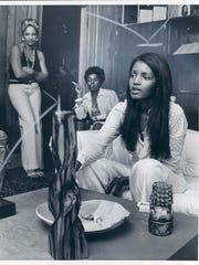 Sylvia Moy, foreground, on Aug. 23, 1974, at her Center for Creative Communications, a studio and rehearsal space. With her are social workers Cal Williams and Fanny Watson.