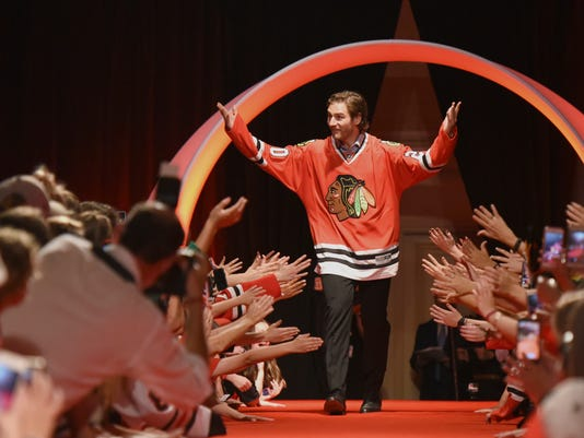 Chicago Blackhawks' Brandon Saad is introduced to the fans during the NHL hockey team's convention Friday, July 21, 2017, in Chicago. (AP Photo/G-Jun Yam)