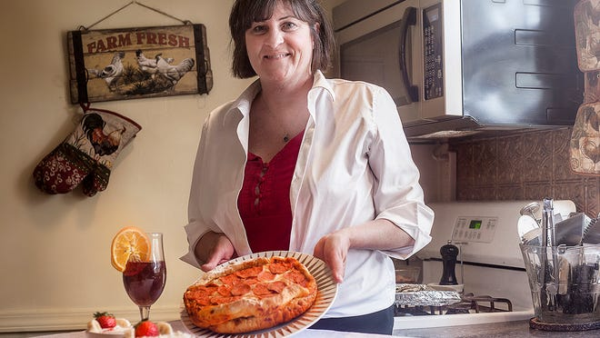 Andrea Keesling in her home kitchen in Alexandria. Keesling, who learned how to cook from her mother and grandmother, is a personal chef.