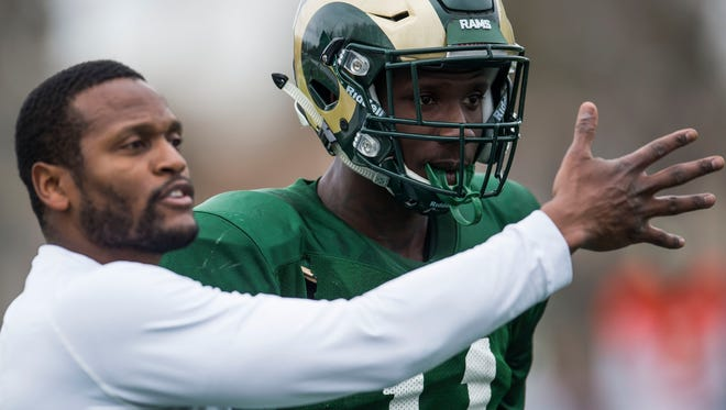 Preston Williams, a transfer from Tennessee, takes instruction from receivers coach Alvis Whitted during an April 4 practice. Williams has still not been cleared to play for the Rams this fall, coach Mike Bobo said Tuesday.