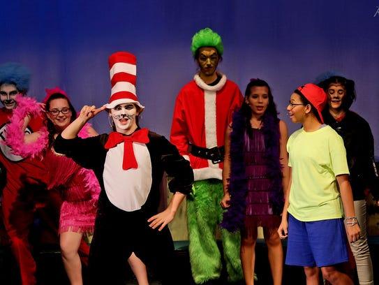 Cast members rehearse a scene from Buena Regional High