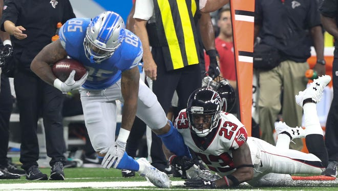 Lions TE Eric Ebron is tackled by Falcons CB Robert Alford in the third quarter of the Lions' 30-26 loss on Sunday, Sept. 24, 2017 at Ford Field.