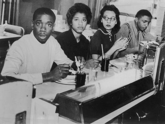 Students eat lunch at the previously segregated counter of the Post House restaurant in the Greyhound bus terminal in Nashville in 1960. From left are Matthew Walker, Peggy Alexander, Diane Nash and Stanley Hemphill.