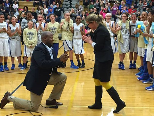Former TSU football player Duvall Young proposed marriage to West Wilson Middle School basketball coach Holly Hudson before a game last week and she said yes.
