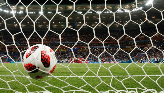 A general view of a World Cup ball in the net.