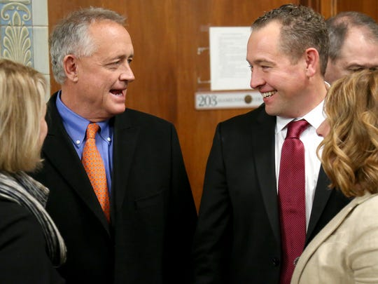Hamilton County Prosecutor Joe Deters, left, talks with his brother, Dennis Deters.