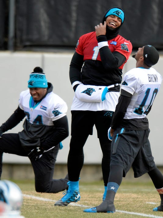 Carolina Panthers' Cam Newton (1) and Corey Brown (10) share a laugh at the start of practice  in Charlotte, N.C., as the team prepares for the NFC Championship game against the Arizona Cardinals, Wednesday, Jan. 20, 2016. (David Foster III\Charlotte Observer via AP)