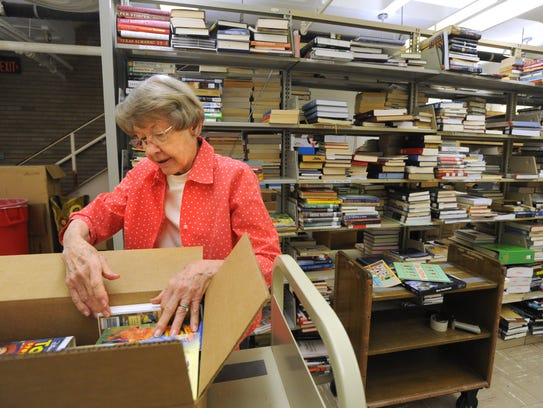 Margaret Basquette sorts books for the 2016 Friends
