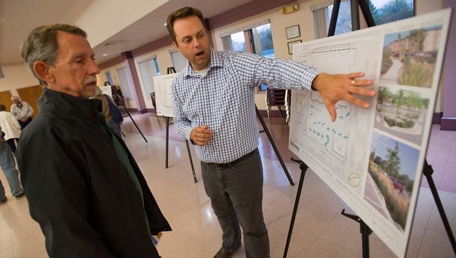 Senior Project Engineer Phil Dalrymple of Galloway talks with Larey Kerling about the expansion of King Soopers during a meeting at Christ United Methodist Church Wednesday, November 2, 2016. The site will take over the former location of Kmart on College Avenue.