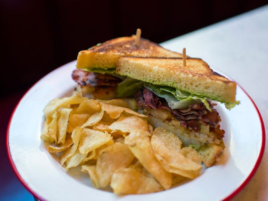 A bacon, latke and tomato sandwich on challah bread with a side of chips. Rooster Soup Company's version of a BLT in Philadelphia.