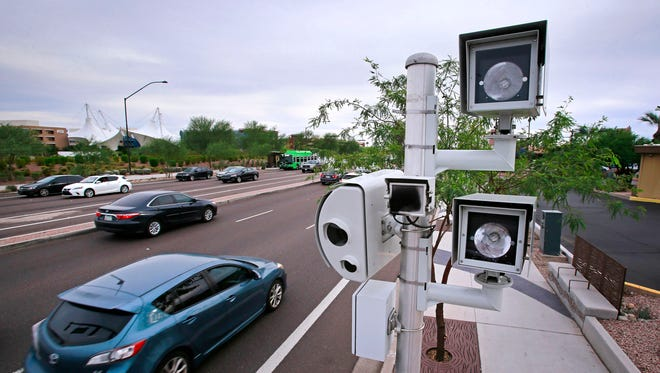 Traffic enforcement camera Sunday, Oct. 25, 2015 at the intersection of McDowell and Scottsdale road in Scottsdale, Ariz.
