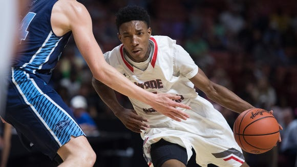 Wade Hampton's Caleb Henry (0) drives toward the basket during the Class AAAAA boys Upper State championship at Bon Secours Wellness Arena on Saturday, February 24, 2018.