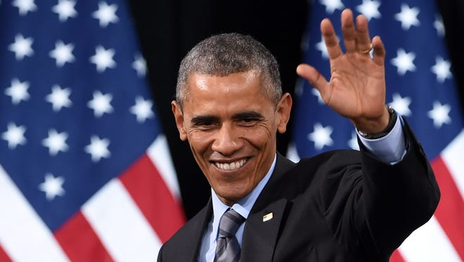 President Barack Obama waves Nov. 21 after speaking about his executive action on U.S. immigration policy at Las Vegas's Del Sol High School.