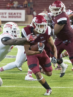 New Mexico State running back Larry Rose III looks toward the end zone in overtime. NMSU defeated Louisana-Lafayette in overtime 37-31 Saturday night at Aggie Memorial Stadium.