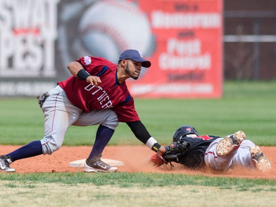 Evansville's Pedro Barrios tags Florence's Cutter McDowell on second base during the ninth inning of an Education Day exhibition game at Bosse Field in Evansville, Ind., on Wednesday, May 2, 2018.