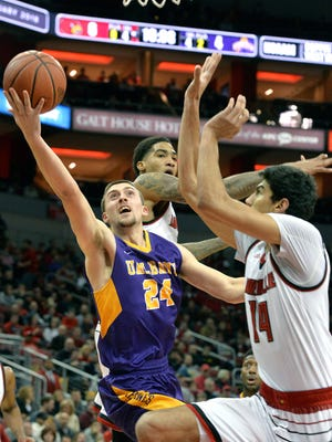 Albany guard Joe Cremo (24) attempts a layup past the defense of Louisville forward Ray Spalding (13), and forward Anas Mahmoud (14) during the first half of an NCAA college basketball game, Wednesday, Dec. 20, 2017, in Louisville, Ky. (AP Photo/Timothy D. Easley)