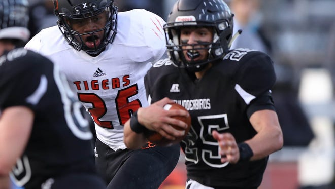 Belleville's Kaevon Merrriweather pursues Dearborn Edsel Ford's Will Marano during the first half of Belleville's 53-0 win on Friday, Sept. 8, 2017, at Edsel Ford.