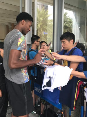 Warriors big man Damian Jones signs autographs for fans in China.