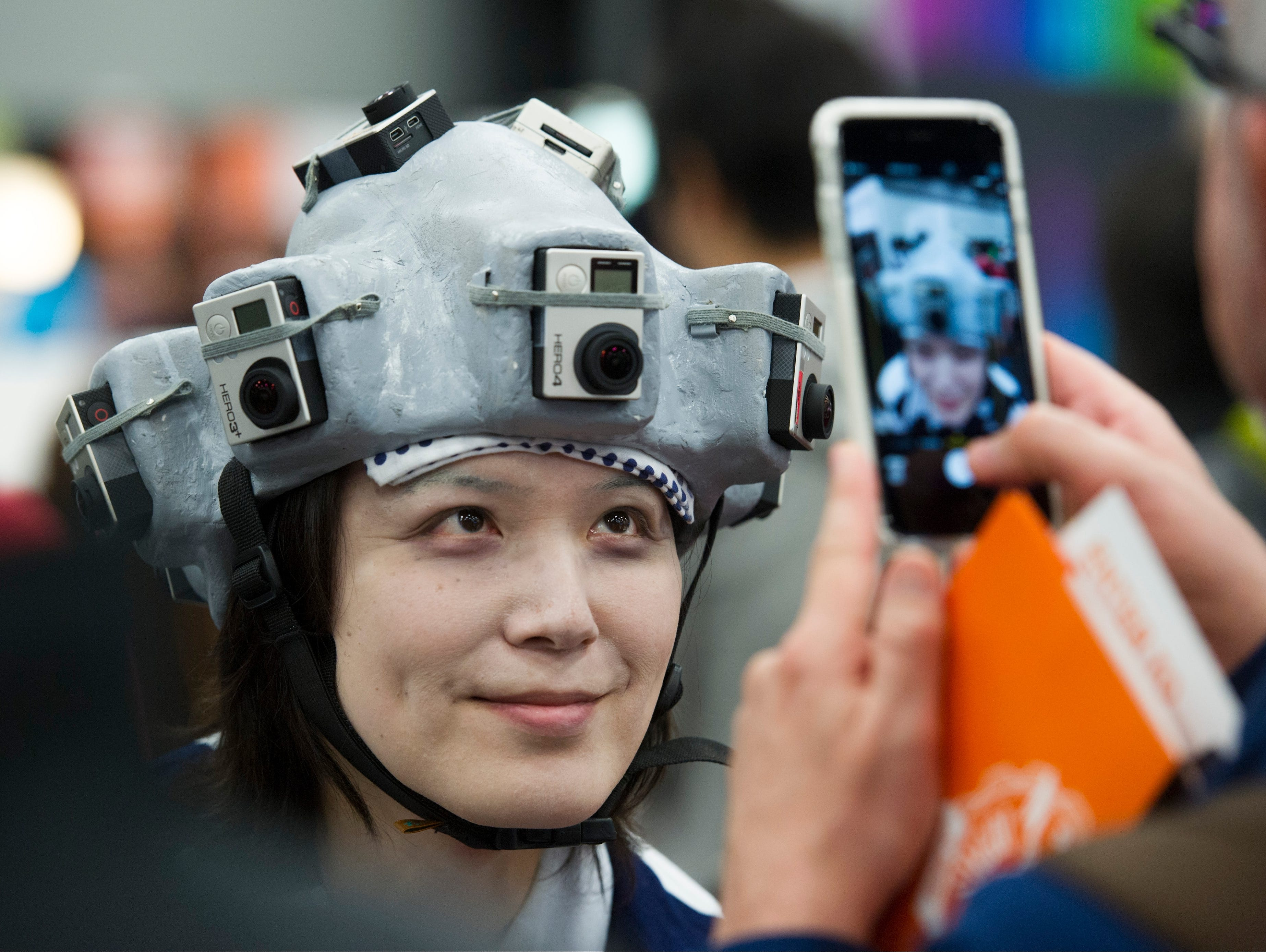 Dverse CEO and Founder Shogo Numakara's image is captured on Day 2 of the SXSW Trade Show, March 15, 2015, in Austin.  Numakara wears a 360-degree panoramic movie headset utilizing ten GoPro devices attached to a helmet to record panoramic movies.