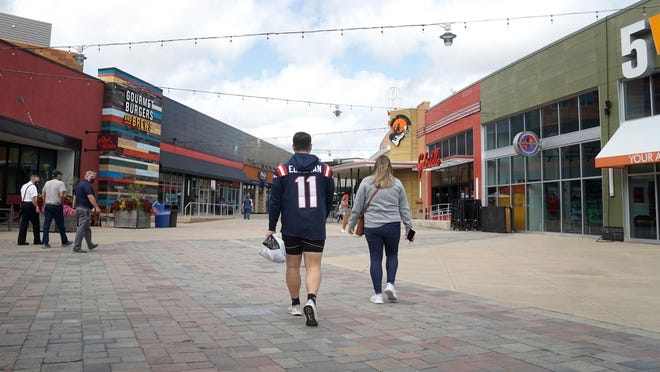 James Karvities and Julia Tierpak walk through an empty upper level of Patriot Place before the season opener. The Patriots played the Miami Dolphin in the 2020 season opener at Gillette Stadium.