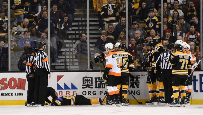 Bruins defenseman Kevan Miller needed help getting off the ice after colliding with Jake Voracek.