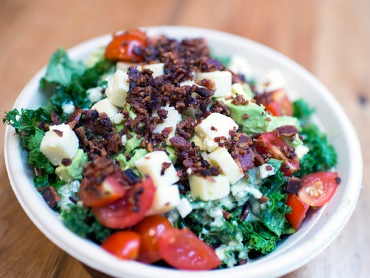 Cobb Caesar ($8.25) shares a base of chopped kale with the Bibimbap, but the chewy greens are balanced by wads of avocado, a cache of bacon crumbles, juicy tomatoes, pleasantly sharp cheddar cubes and a kickass Caesar dressing.