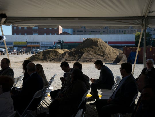 Attendees take a seat next to a construction for the