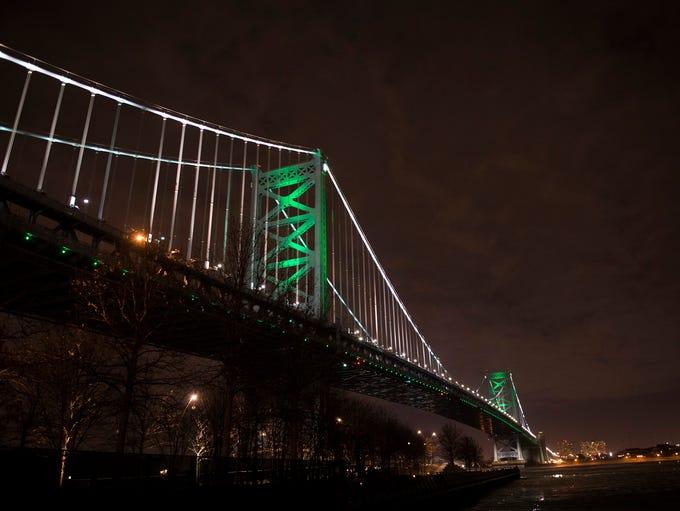 The Ben Franklin Bridge is lit green in support of
