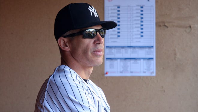 New York Yankees manager Joe Girardi (28) in the dugout before a game against the Chicago White Sox at Yankee Stadium.