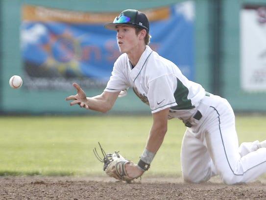 El Diamante's Luke Garispe shovels a ball for an out