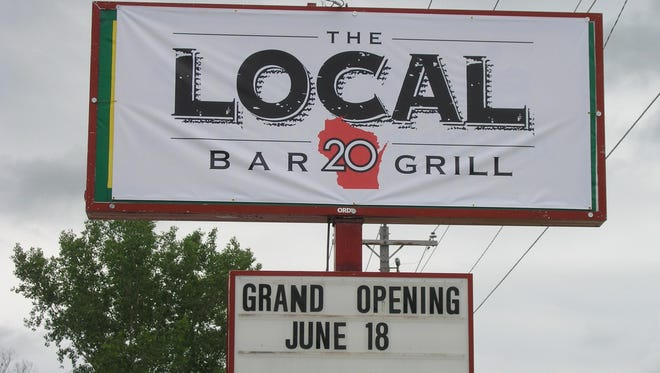 The Local 20 Bar & Grill on Manitowoc Road in Bellevue held its grand opening Thursday. It is the former Charneski's Diamond Inn.